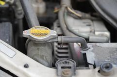 Coolant checkup automobile dirty engine bay Stock Photo
