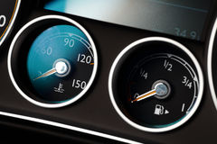 Coolant and gas. Coolant temperature and fuel level gauges on a car's dashboard Stock Photo