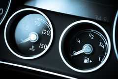 Coolant and gas. Coolant temperature and fuel level gauges on a car's dashboard Royalty Free Stock Photos