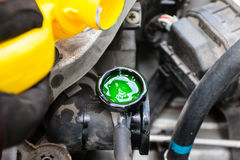 Coolant level. Mechanic waiting for a coolant to drop Stock Images