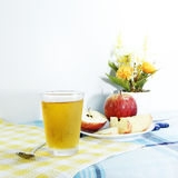 Cooled apple juice set on tablemat Stock Image