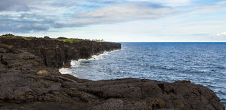 Cooled lava cliffs, East Rift Zone, Kilauea, Hawaii. Over the years multiple  lava flows from active Kīlauea Volcano travel miles to  the Pacific ocean,  slowly Stock Photos