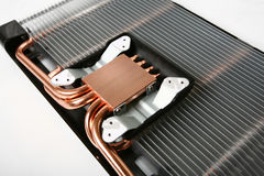 Cooler. This is a photo of a base of a gpu (graphic processor unit) cooler. It's smooth surface conducts heat trough heat pipes to cooling radiator Royalty Free Stock Image