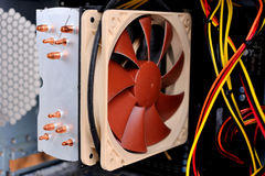 Cooler computer fan equipment placed on motherboard. Royalty Free Stock Photography