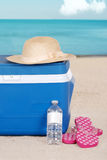 Cooler woman hat and sandals on the beach Royalty Free Stock Photography