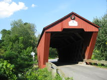 Cooley bridge. The Cooley Bridge is a single span covered bridge built in 1849 by Nicolas Powers. It crosses the Furnace Brook and is 53 long and is of lattice Stock Photos