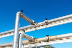 Cooling Chiller or Steam Pipeline and Insulation of Manufacturing in Oil and Gas Industrial, Petrochemical Distribution Pipe at. Refinery Plant. Overhead Steel stock images