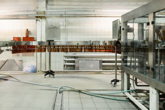 Cooling conveyor for plastic bottles. Before filling machine. Stock Image