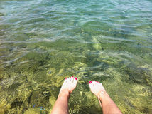 Cooling down on the sea. Legs cooling down in the sea. Croatia stock photography