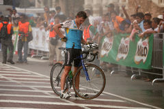Cooling down with water sprays. Cyclist cooling down in a spray of water at the end of the race. This is the seventh stage of the international bicycle race, le Royalty Free Stock Images