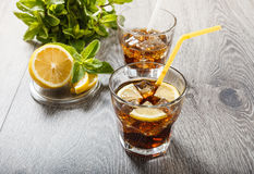 The cooling drink with ice, lemon and mint. Stock Photo