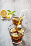 The cooling drink with ice, lemon and mint. Royalty Free Stock Photos