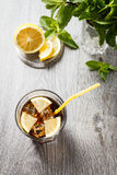 The cooling drink with ice, lemon and mint. Royalty Free Stock Images