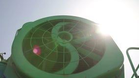 Cooling fan of combine. In sun lights stock footage