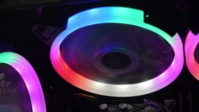 Cooling Fans Illuminated by LEDs Inside Personal Computer. Desktop Gaming PC with multicolored RGB lights stock video