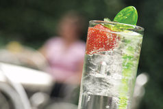 Cooling glass of lemonade drink. Could be lomonade with ice or a gin and tonic drink Royalty Free Stock Image