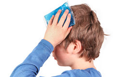 Cooling with ice pack. Person is cooling with an ice pack because of headache, school stress, insect sting, blain or others royalty free stock image