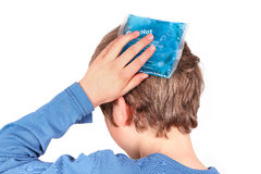 Cooling with ice pack. Person is cooling with an ice pack because of headache, school stress, insect sting, blain or others stock photo