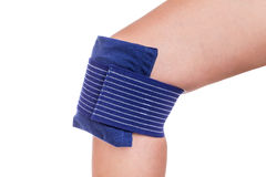 Cooling the injured knee. Stock Photography