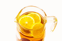 Cooling lemonade with lemon slices in a glass jug Stock Photos