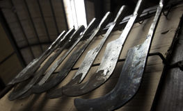 Cooling Metal tools hanging from a blacksmith`s rack Royalty Free Stock Images