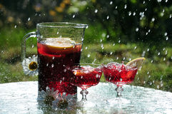 Cooling off. Sunshine or rain, quench your thirst Royalty Free Stock Photos