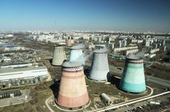 Cooling pipes are several nearby in the city. Photo of a cooling tower in a megacity with a close-up view Stock Image