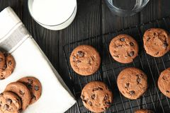 Cooling rack with chocolate chip cookies on wooden background stock photos
