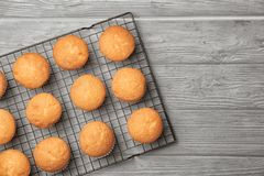 Cooling rack with delicious cupcakes Stock Photos
