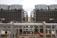 Cooling tower 1. Two sets of cooling towers in symmetry royalty free stock photography