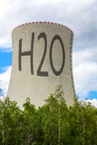 Cooling tower of nuclear power plant with the inscription H2O Royalty Free Stock Image