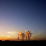 Cooling tower poultion at sunset. Global warming Stock Images