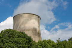 Cooling-tower of a power plant producing electricity royalty free stock photo