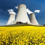 Cooling tower and rapeseed field Stock Photos