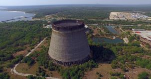 Cooling tower unfinished srade of the Chernobyl nuclear power plant (Aerial) stock footage