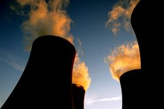 Cooling towers. With smoke at sunset stock image