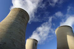Cooling Towers. Detail of power station cooling towers & steam plumes stock photo