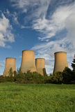 Cooling towers. The cooling towers of a power station against a blue sky royalty free stock image