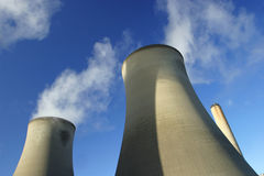 Cooling Towers. Steam rising from a power station's cooling towers Royalty Free Stock Photo