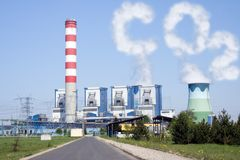 Cooling towers with CO2 clouds from chimney. Power plant with chimney and cooling towers with CO2 clouds Stock Photos