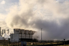 Cooling towers with condensation Royalty Free Stock Photography
