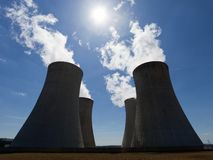 Cooling towers with contrejour lighting and beautiful sky Royalty Free Stock Image