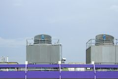Cooling towers on daylight on the purple floor Stock Images