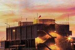 Cooling towers emitting steam with twilight Royalty Free Stock Photography