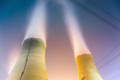 Cooling towers at night Stock Photos