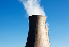 Cooling towers of nuclear power plant against blue sky Stock Image