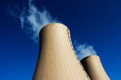 Cooling towers of nuclear power plant against  blue sky Royalty Free Stock Images