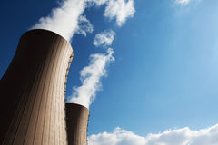 Cooling towers of nuclear power plant against the sky Stock Images