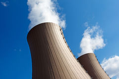Cooling towers of a  nuclear power plant against sky and clouds Royalty Free Stock Photo
