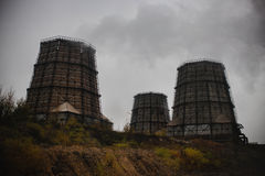 Cooling towers of a nuclear power plant. concept   gloomy state  environment. Stock Images